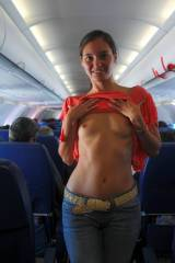 Flashing her little tits on the plane