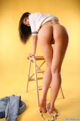 Jasmin leans on a ladder