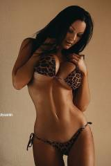 Veronika Black barely contained by a leopard bikin...