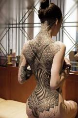 Girl with insane back tattoo