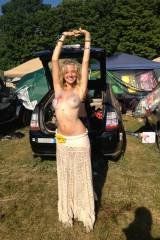 Busty and topless blonde hippie