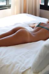 Bare on the bed