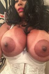 Exotic lady with succulent breasts and big areolas