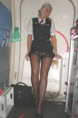 Lufthansa Stewardess pulling up her dress