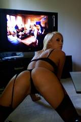 Hot blonde in black lingerie showing off her ass