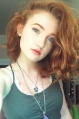 A lovely redheaded lass with fine features, fair s...