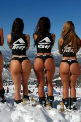 Girls showing their backside wide promoting Reef a...