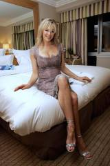 Classy MILF on the bed
