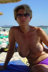 Topless short hair MILF at the beach