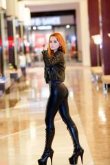 Sexy redhead in stilettos at the mall.