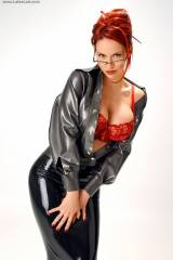 Bianca Beauchamp with an open top and a red bra......