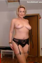 Beautiful MILF in black lingerie, stripping down.