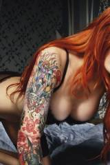 Hot inked Redhead on all fours...