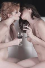 Faye Reagan and a friend share a glass of wine
