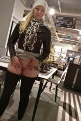 Showing pussy at furniture store in Sweden