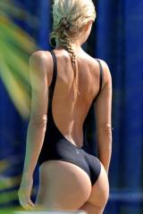 One piece suit reveals her curvy bottom
