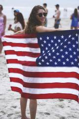 American babe with her flag at the beach (x-post /...