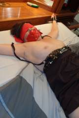 My wife spreadeagle,tape gagged and blindfolded,pm...