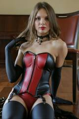 Cutie in a leather corset and stockings. [x-post /...