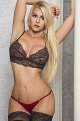 Blonde in tiny red panties and a black bra full of...