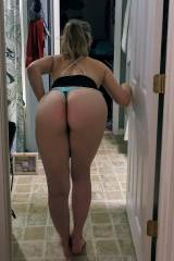 Wife bending over.