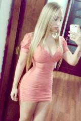 Cute blonde in her thight dress